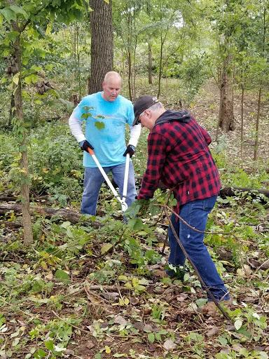 Lee Davis leading honeysuckle cleanup