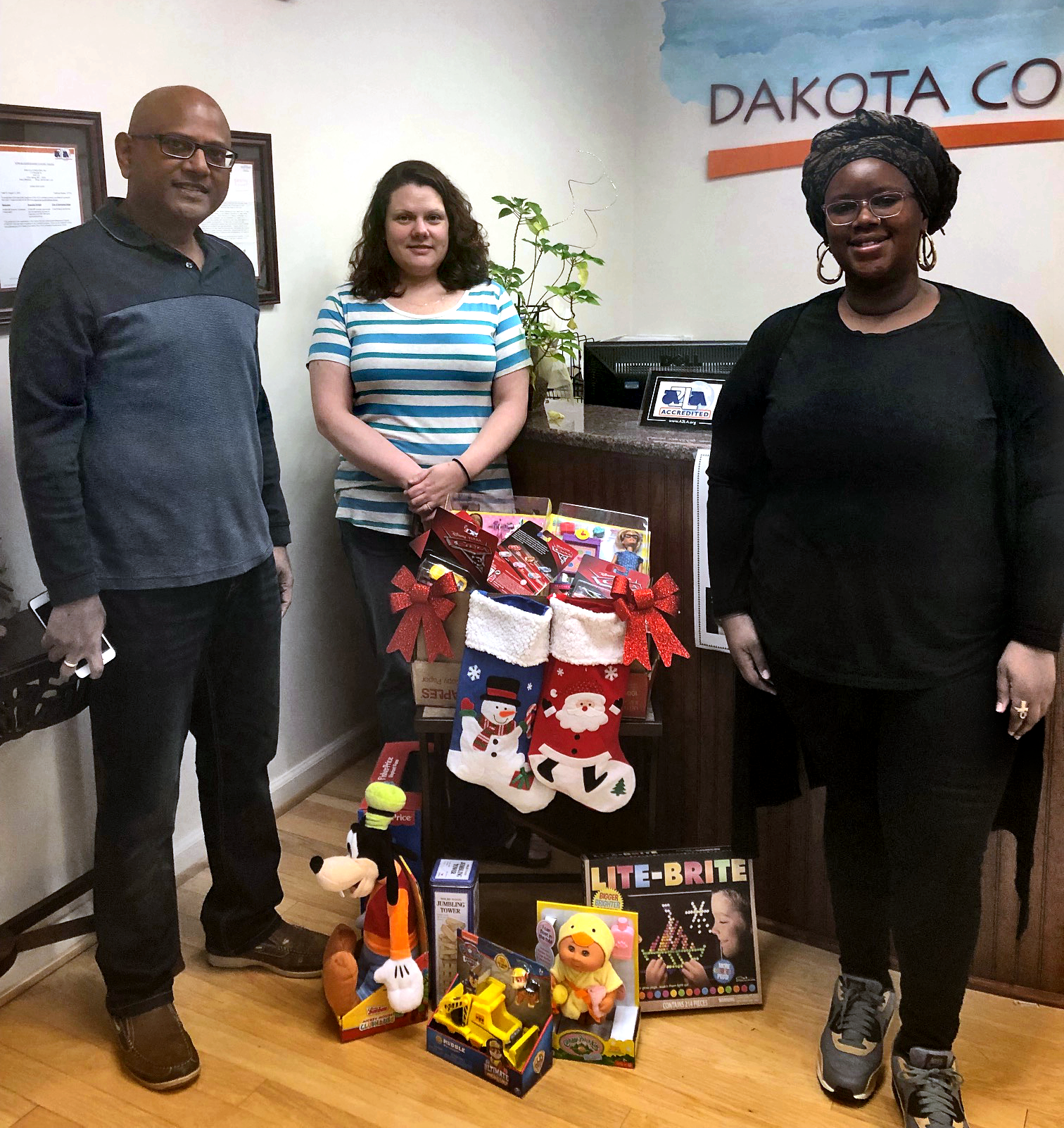 Dakota Employees with collected toys